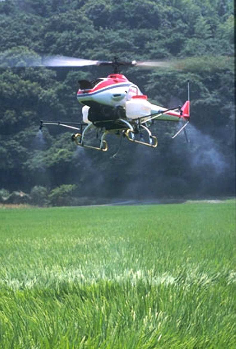 Yamaha has recently received permission in the United States to fly a helicopter type of crop spraying drone, called the RMax.
