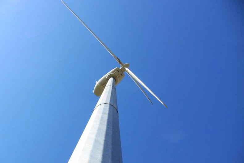 Wind turbine made by Galway-based C&F Green Energy on the farm of Gilbert Cosson in Brittany, France.