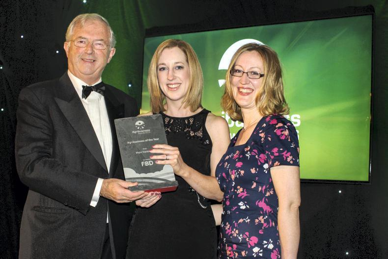 Eibhlin Murphy and Aine Lecky from Major Equipment Intl Ltd accepting their award from Mr. Michael Berkery, Chairman FBD
