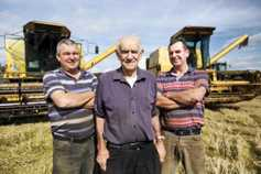 Farmers grab grain as straw sits and waits
