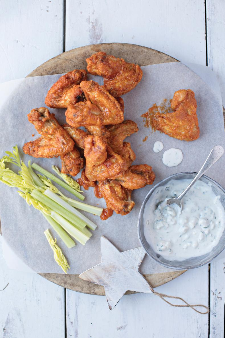 Crispy chicken wings with blue cheese dip.