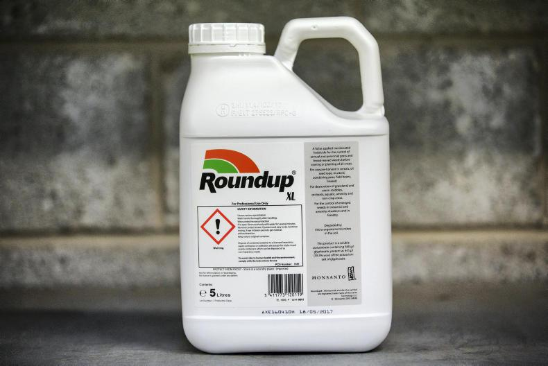 Roundup spray containing glyphosate. \ Donal O'Leary