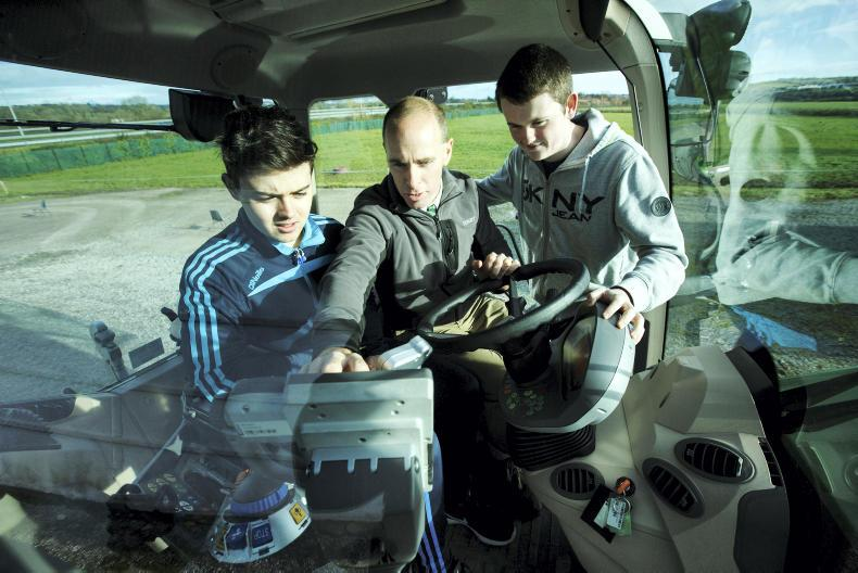 Sean Gorman, Fendt Area Sales Manager goes through the safety features in Fendt tractors with Safe Family Farms Competition winners Padraig Hunt and Michael Murphy from St Michaels College, Listowel before they take part in the Fendt Driving Experience in association with ESB Networks and Aitkins Cork.