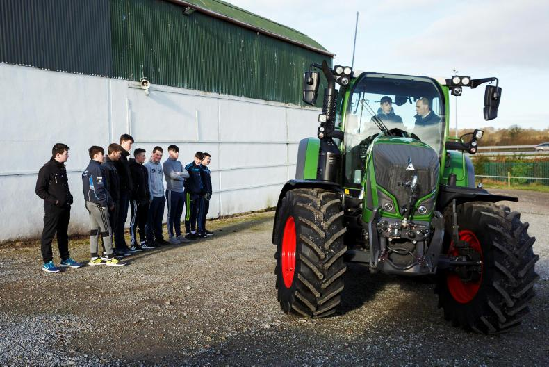 Students from St Michaels College, Listowel look on as Sean Keane drives a Fendt tractor with Sean Gorman, Fendt Area Sales Manager as part of the Fendt Driving Experience in association with ESB Networks and Aitkins Cork.
