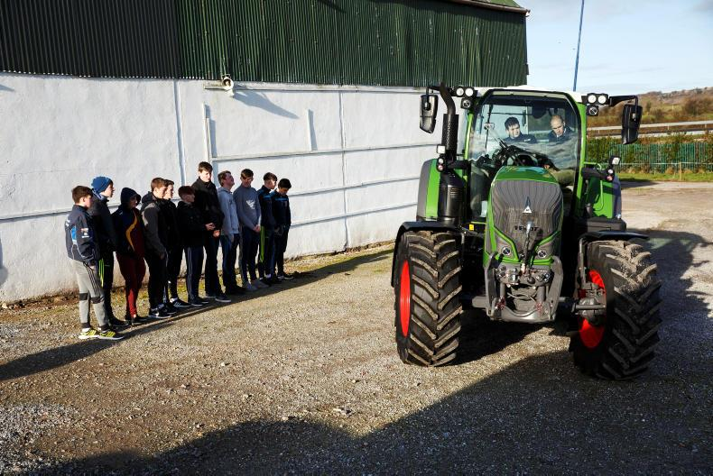 Students from St Michaels College, Listowel look on as Brendan O' Shea drives a Fendt tractor with Sean Gorman, Fendt Area Sales Manager as part of the Fendt Driving Experience in association with ESB Networks and Aitkins Cork.