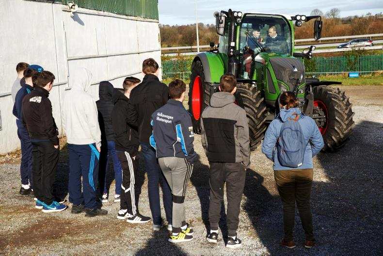 Students from St Michaels College, Listowel look on as Cathal Horan drives a Fendt tractor with Sean Gorman, Fendt Area Sales Manager as part of the Fendt Driving Experience in association with ESB Networks and Aitkins Cork.