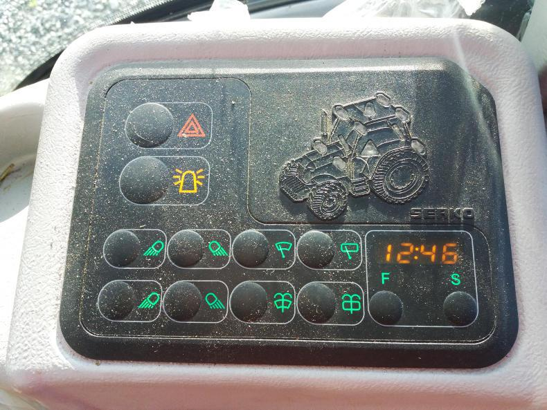 A compact panel on the right hand side controls lights, wipers, hazards adn beacon. It also contains a clock