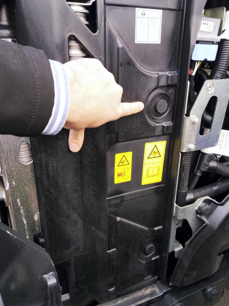 Two plastic shields on either side of the radiator reduce the amount of debris drawn into the cooling package.