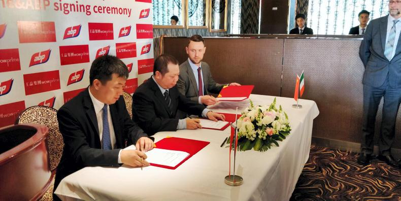 ABP's Mark Goodman signing a contract in Shanghai to supply beef to restaurant chain Wowprime.